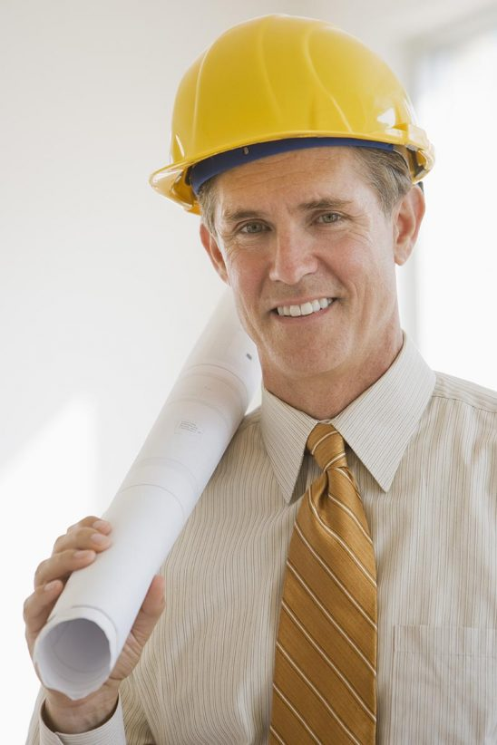 Free stock photo Architect with blueprints and hard hat