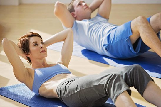 Free stock photo Excercising group doing situps on mats