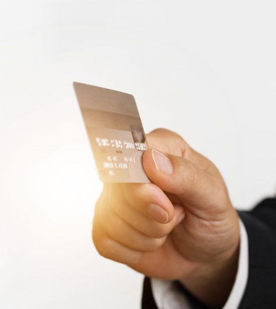 Free stock photo Business man's hand holding a credit card