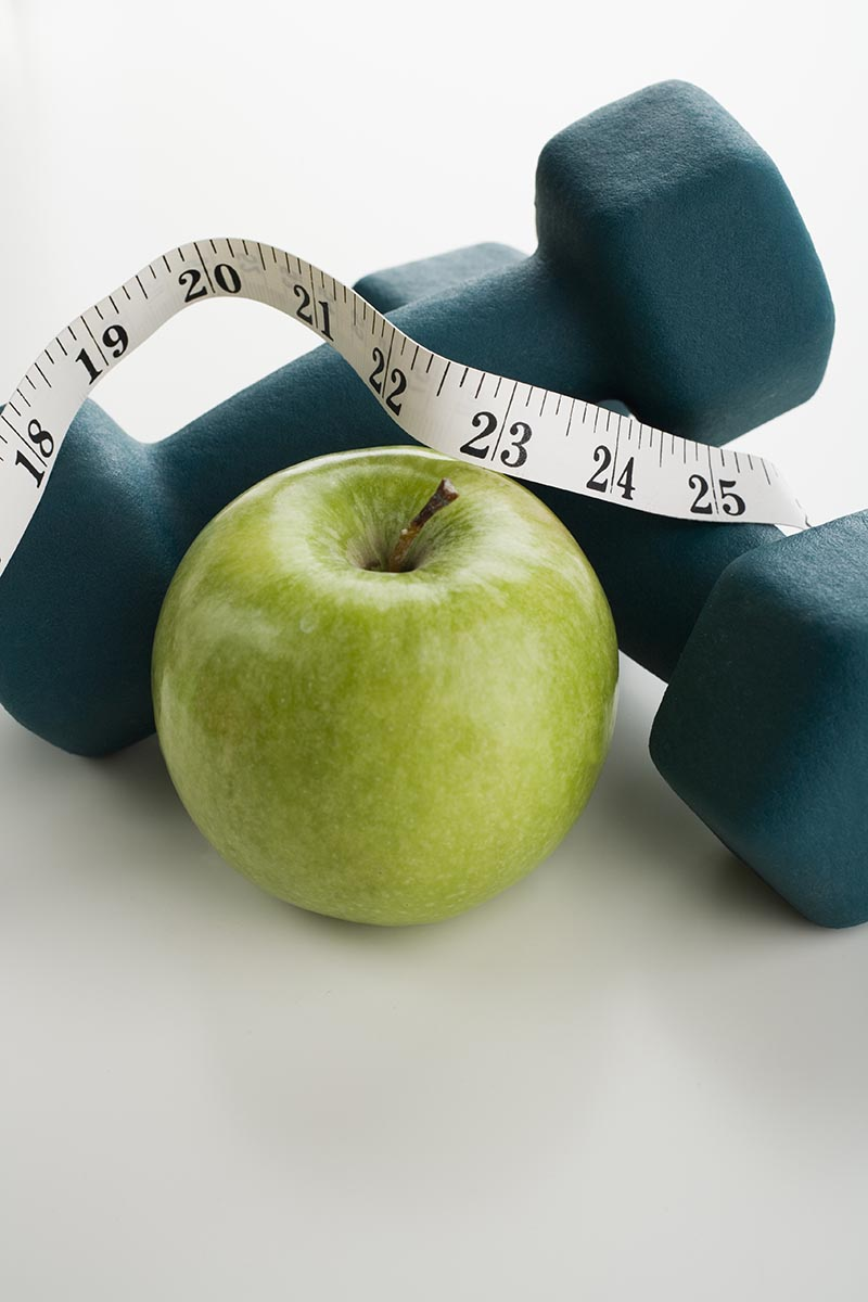 Free stock photo Apple and tape measure and hand weights