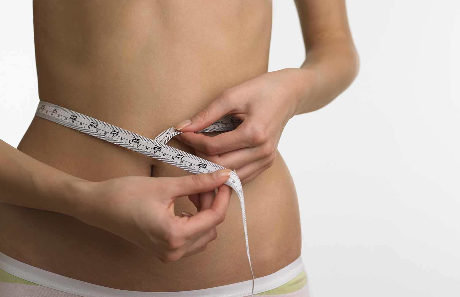Free stock photo Woman measuring her waist line