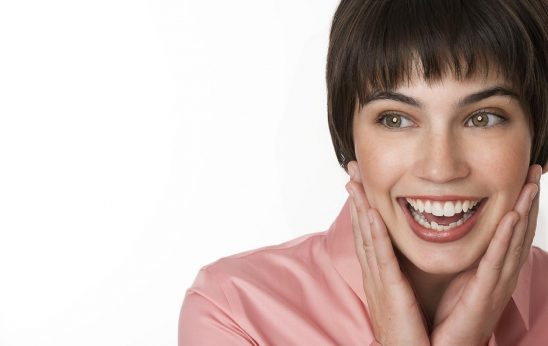 Free stock photo Portrait of a brunette woman with a surprised expression on her face.