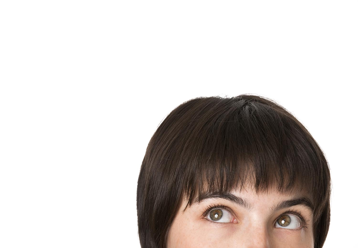 Free stock photo Close-up of a brunette woman looking up.