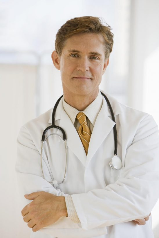 Free stock photo Doctor with arms crossed looking at camera
