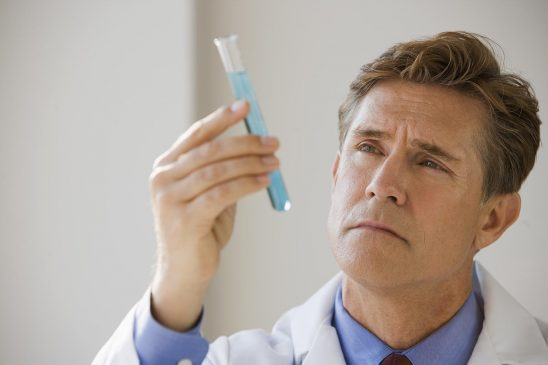 Free stock photo Medical professional examining a test tube