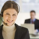 Free stock photo Business woman with headphone in office