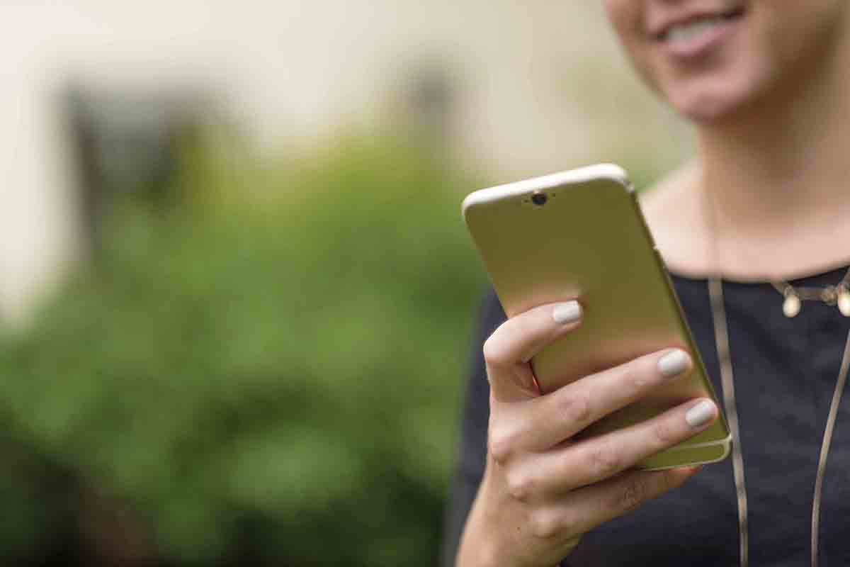 Free stock photo Cropped image of woman using smart phone in park