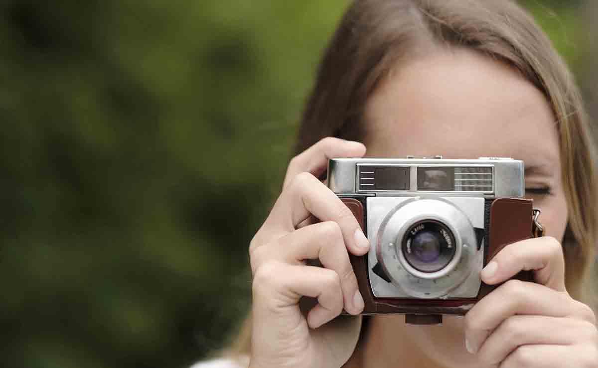 Free stock photo Close-up of woman using vintage camera