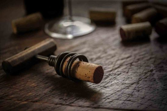 Free stock photo Close-up of corkscrew and cork on wooden table