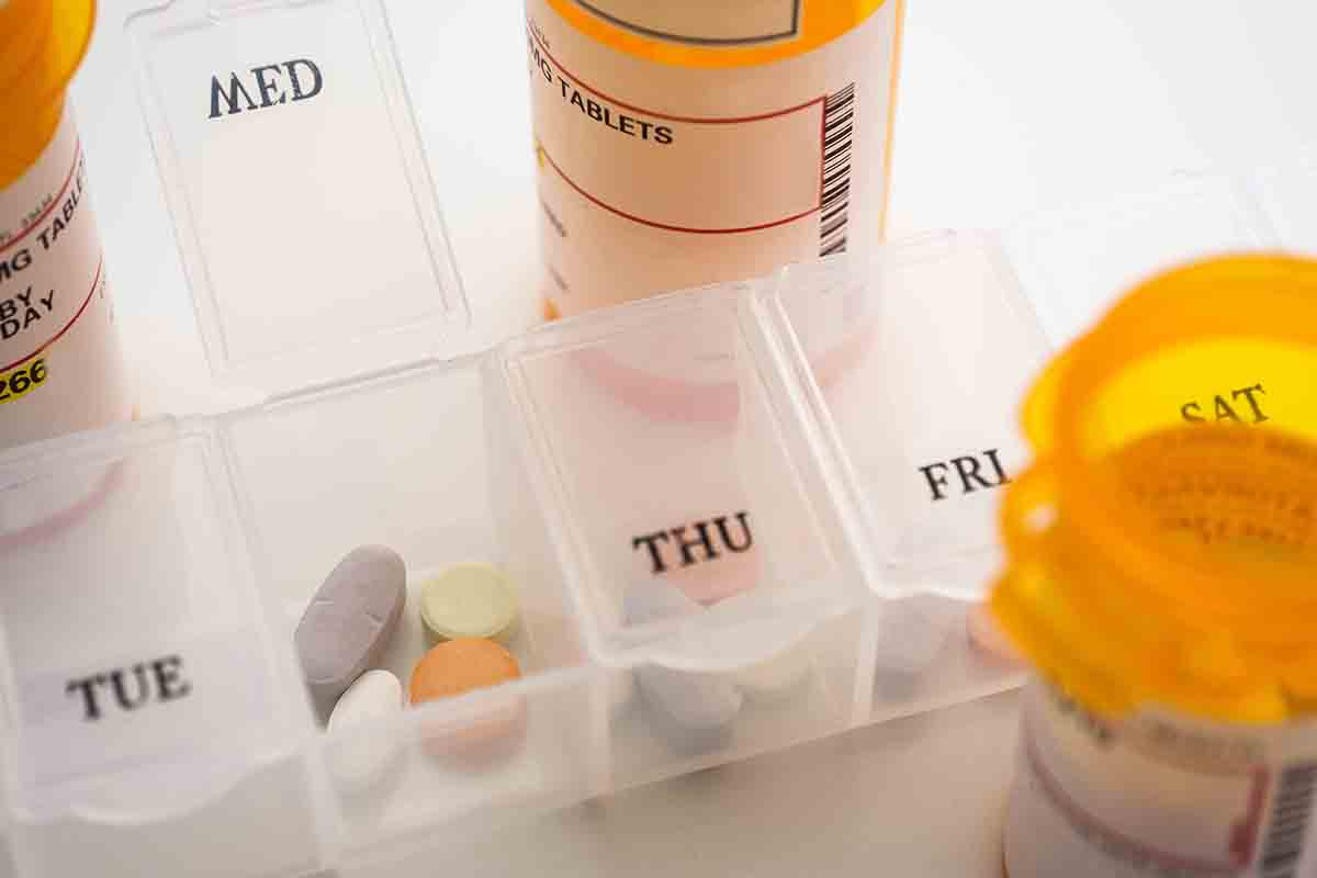 Free stock photo Close-up of pills organizer and bottles