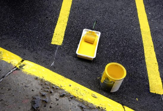 Free stock photo Painting yellow guides on a street