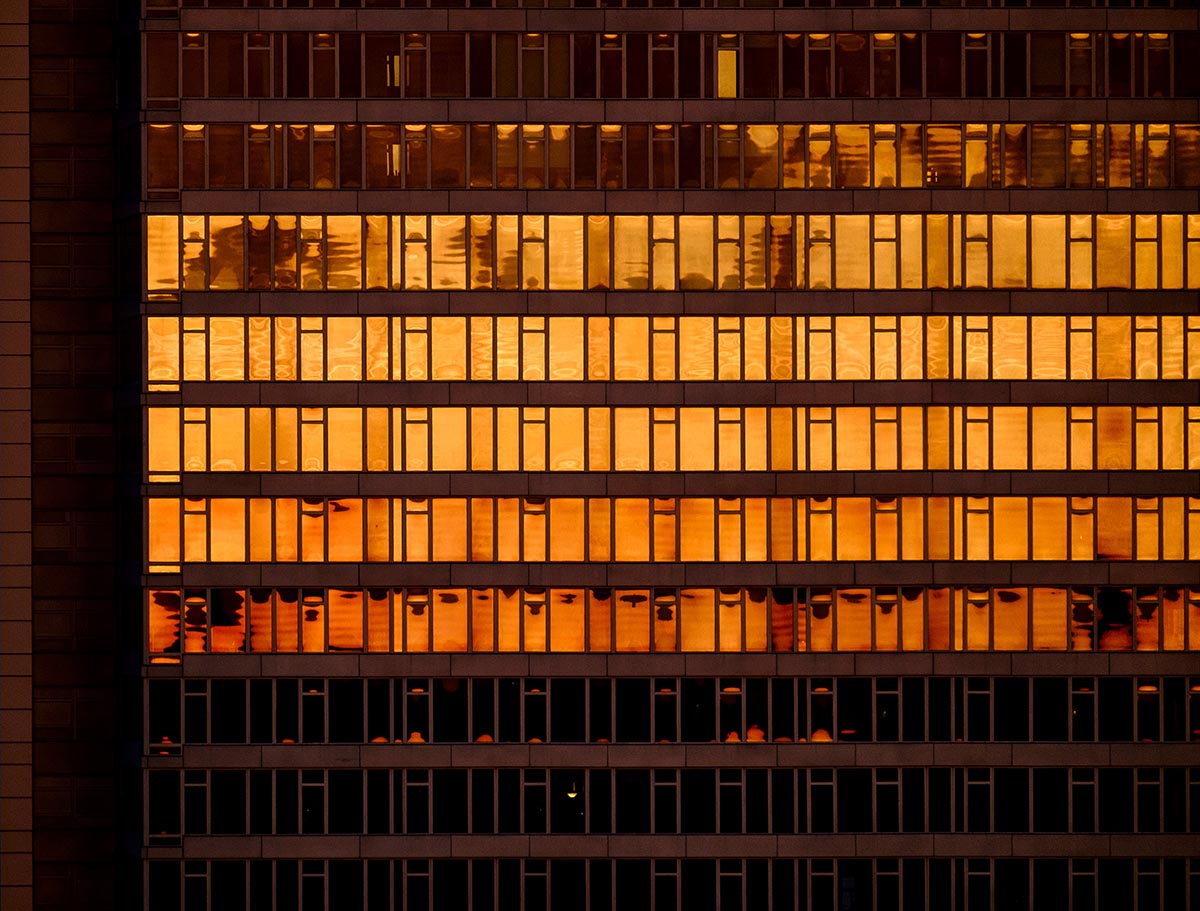 Free stock photo Sunset reflections in a glass building facade