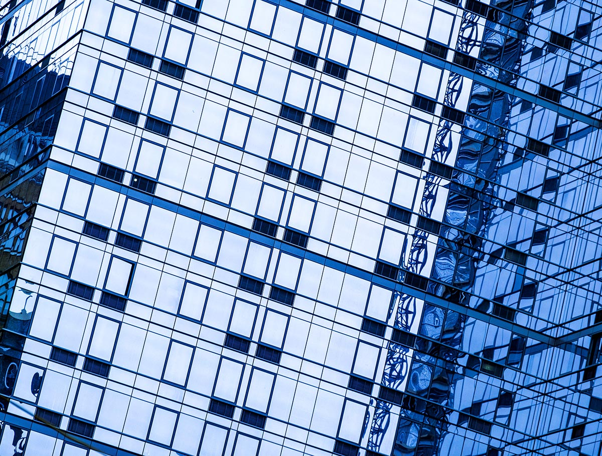 Free stock photo Blue grid pattern of office building windows