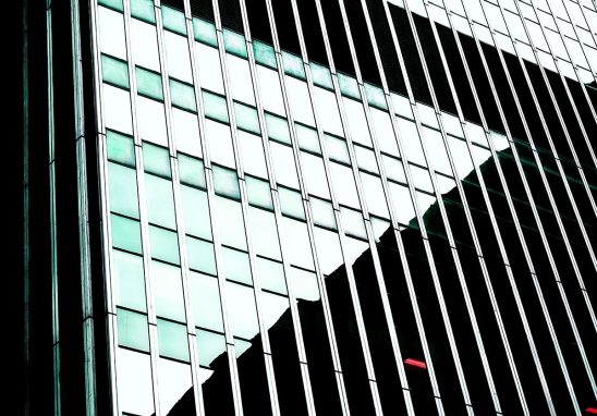 Free stock photo Geometric background pattern of skyscraper windows