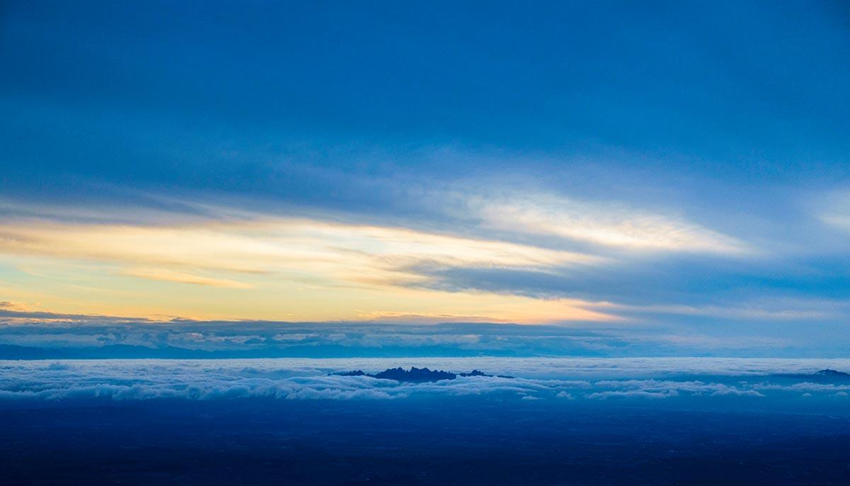 Free stock photo Montserrat mountain range breaking through the clouds