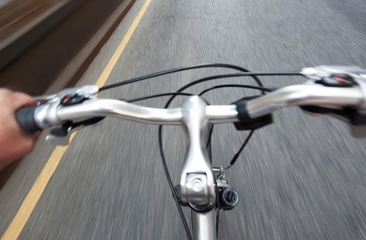 Free stock photo Bicycle handlebars along a roadway