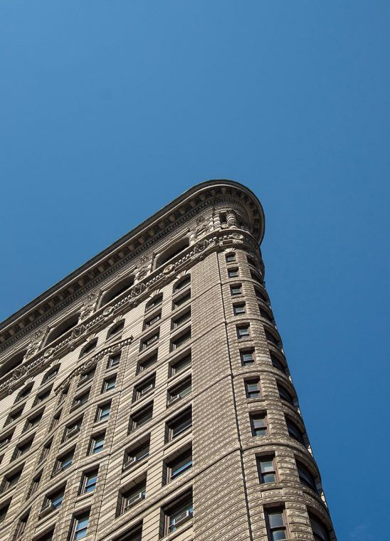 Free stock photo Top of the Flatiron Building against a blue sky