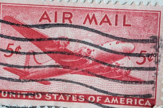 Free stock photo Vintage United States air mail stamp with propeller airplane