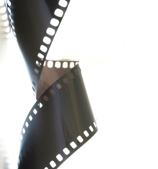 Free stock photo Graphic background of a roll of 35mm film