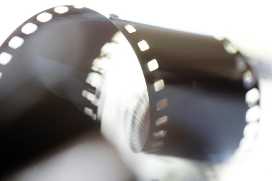 Free stock photo Backlit close up of roll of 35mm film stip