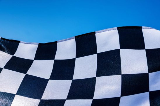 Free stock photo Background image of a checkered flag and blue sky