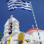 Free stock photo White-washed church and Greek flag in Mykonos, Greece