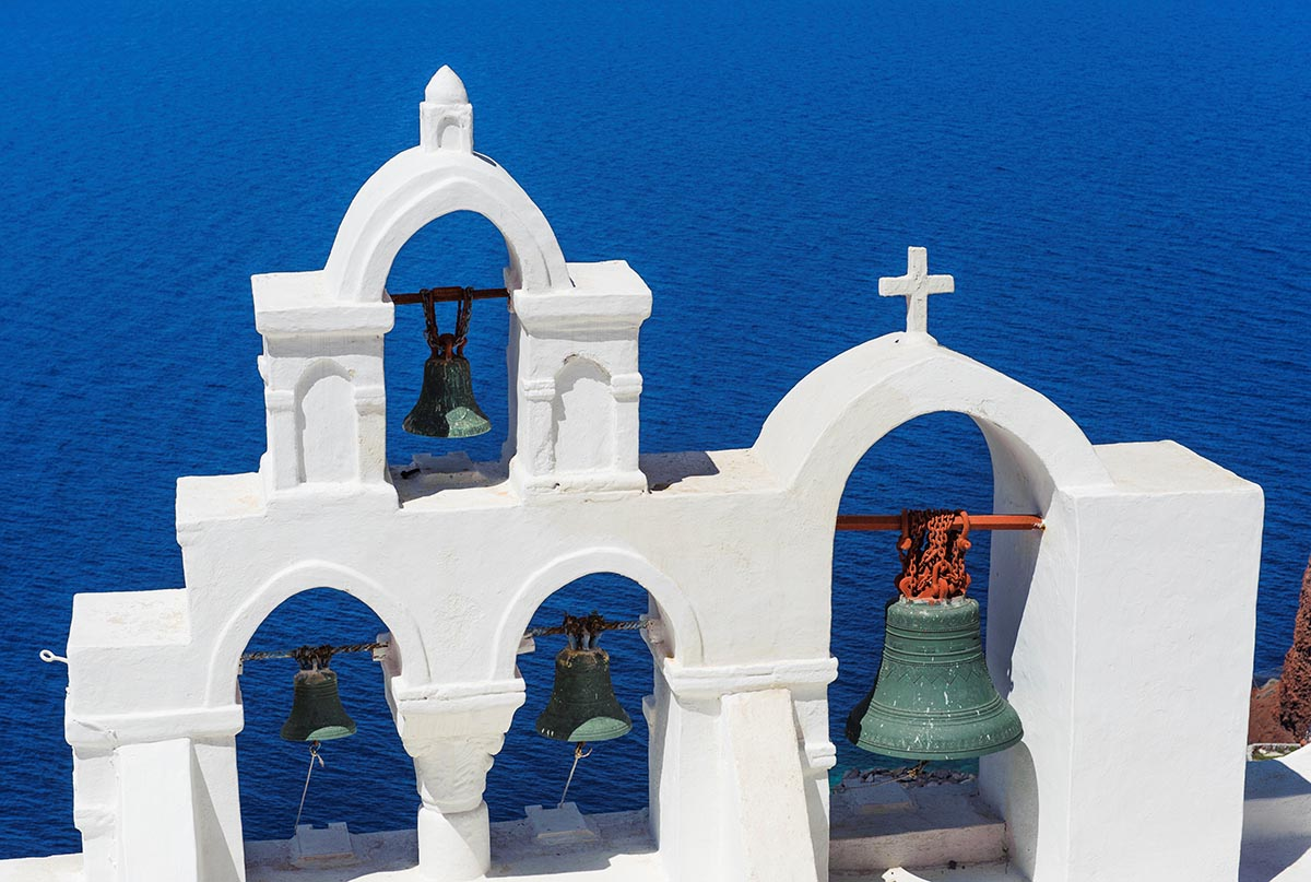 Free stock photo Chruch bells on Santorini against a blue Aegean Sea