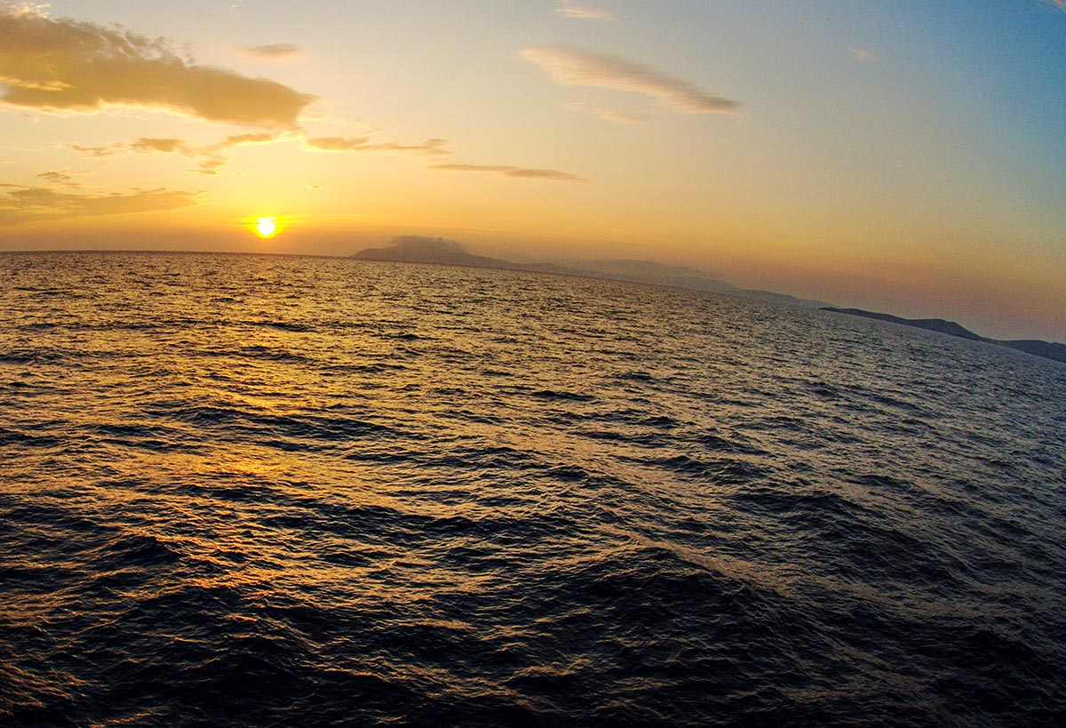 Free stock photo Setting sun over the ocean and Greek isles