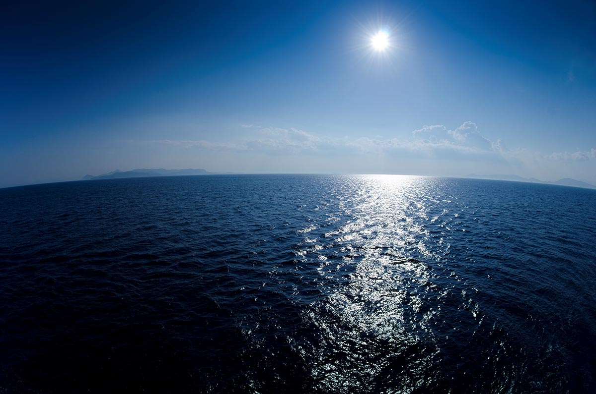 Free stock photo Bright sun shining off the ocean waters