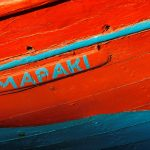 Free stock photo Close up of an old red and blue fishing boat on Mykonos