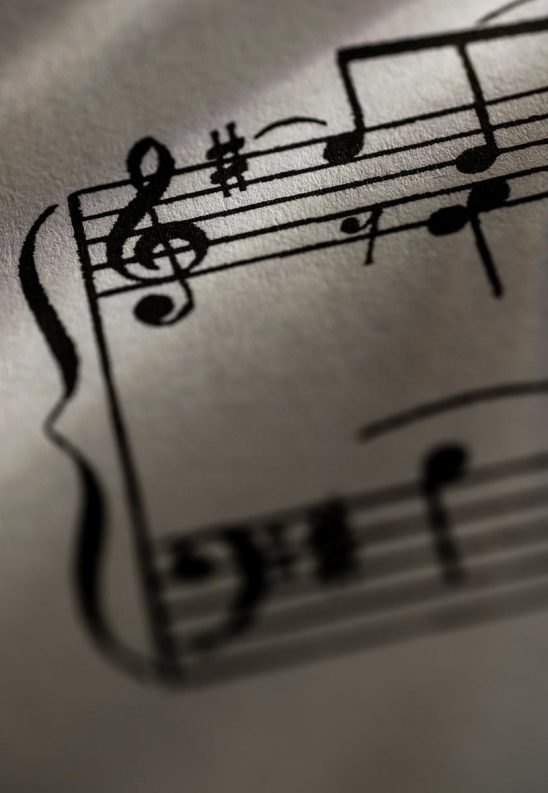 Free stock photo Close up of a treble clef on a sheet of music