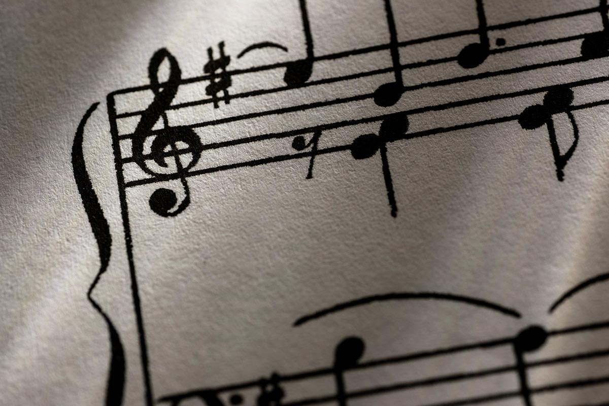 Free stock photo Close up of a treble clef and notes on a sheet of music