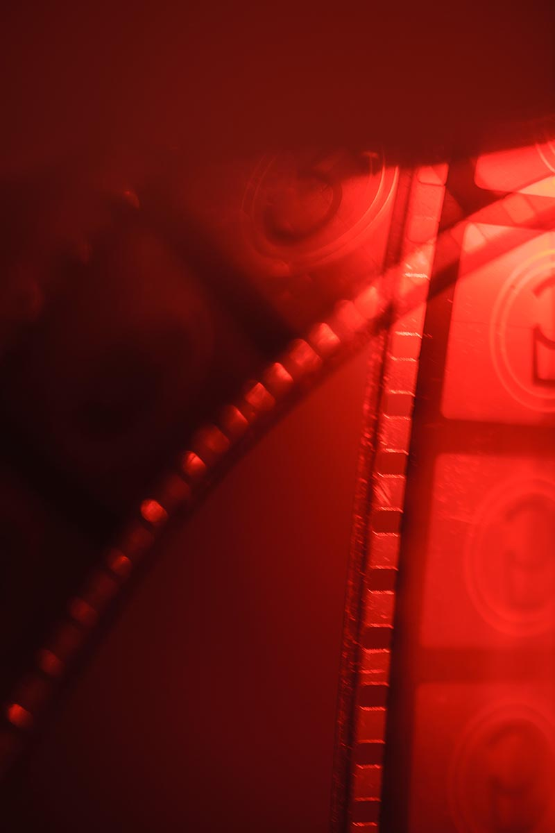 Free stock photo Close up of movie film strips on a red background