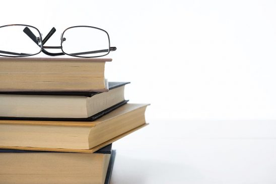 Free stock photo Stack of books with eyeglasses