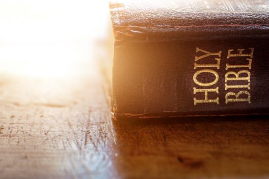 Free stock photo Old Holy Bible resting on a table