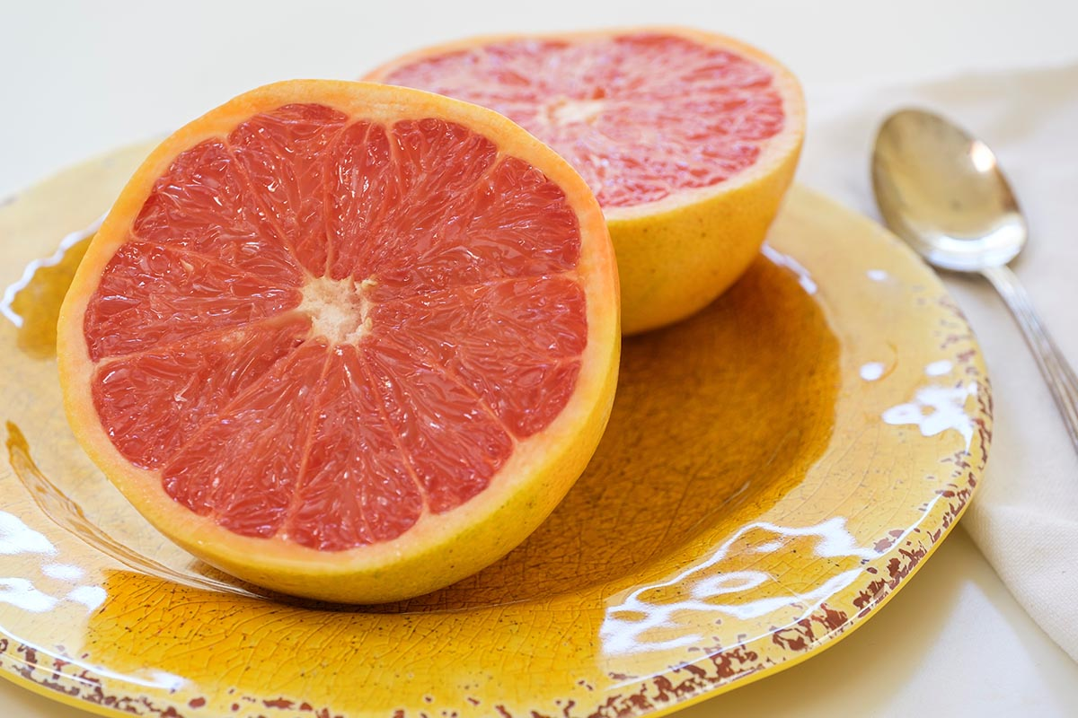 Free stock photo Grapefruit cut in half on a plate