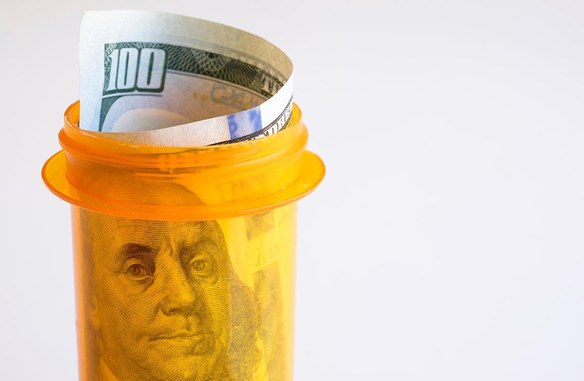 Free stock photo Prescription bottle with hundred dollar bill