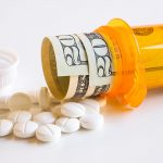 Free stock photo Pills and prescription bottle with money