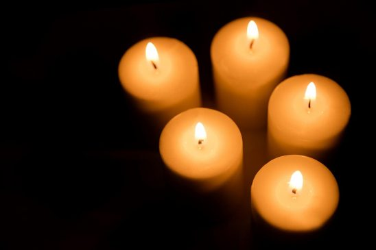Free stock photo Overhead view of a cluster of lit candles against a dark background