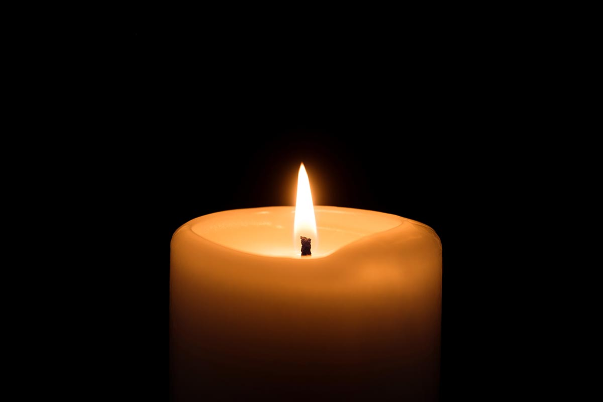 Free stock photo Horizontal view of a lone candle against black