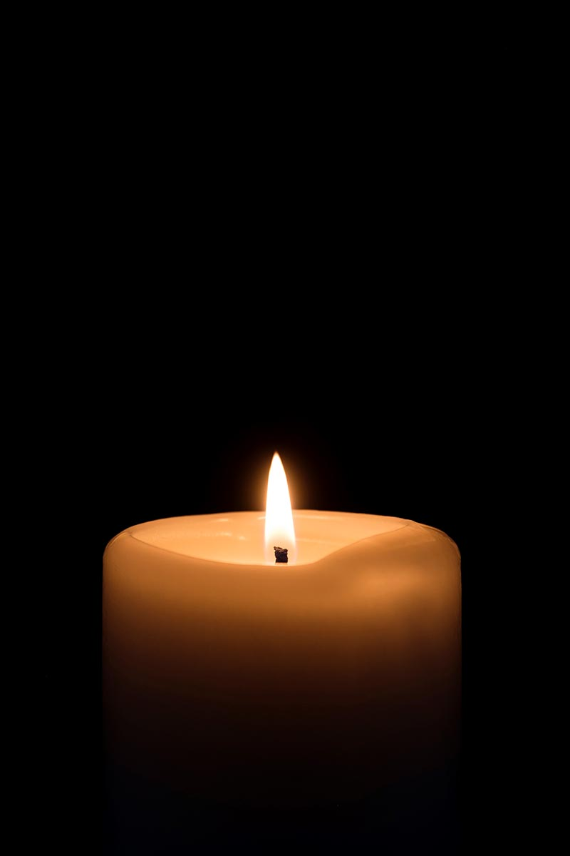 Free stock photo Vertical view of a candle against a black background
