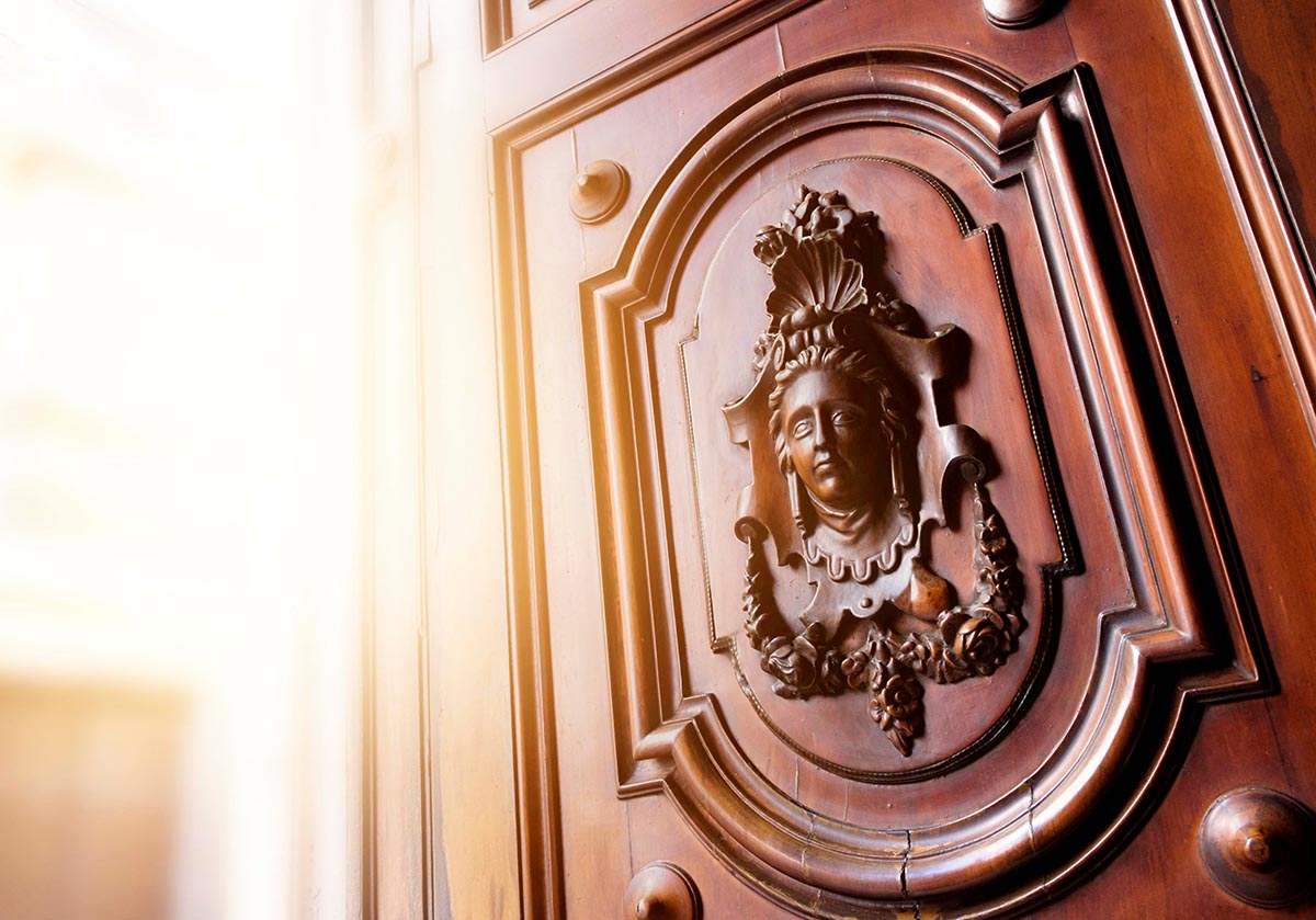 Free stock photo Decorative carving of a woman's portrait on a wooden door in Cadiz, Spain