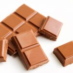 Free stock photo Squares of milk chocolate on a white background