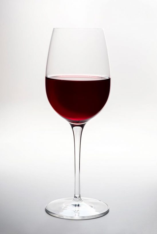 Free stock photo A glass of red wine against white background