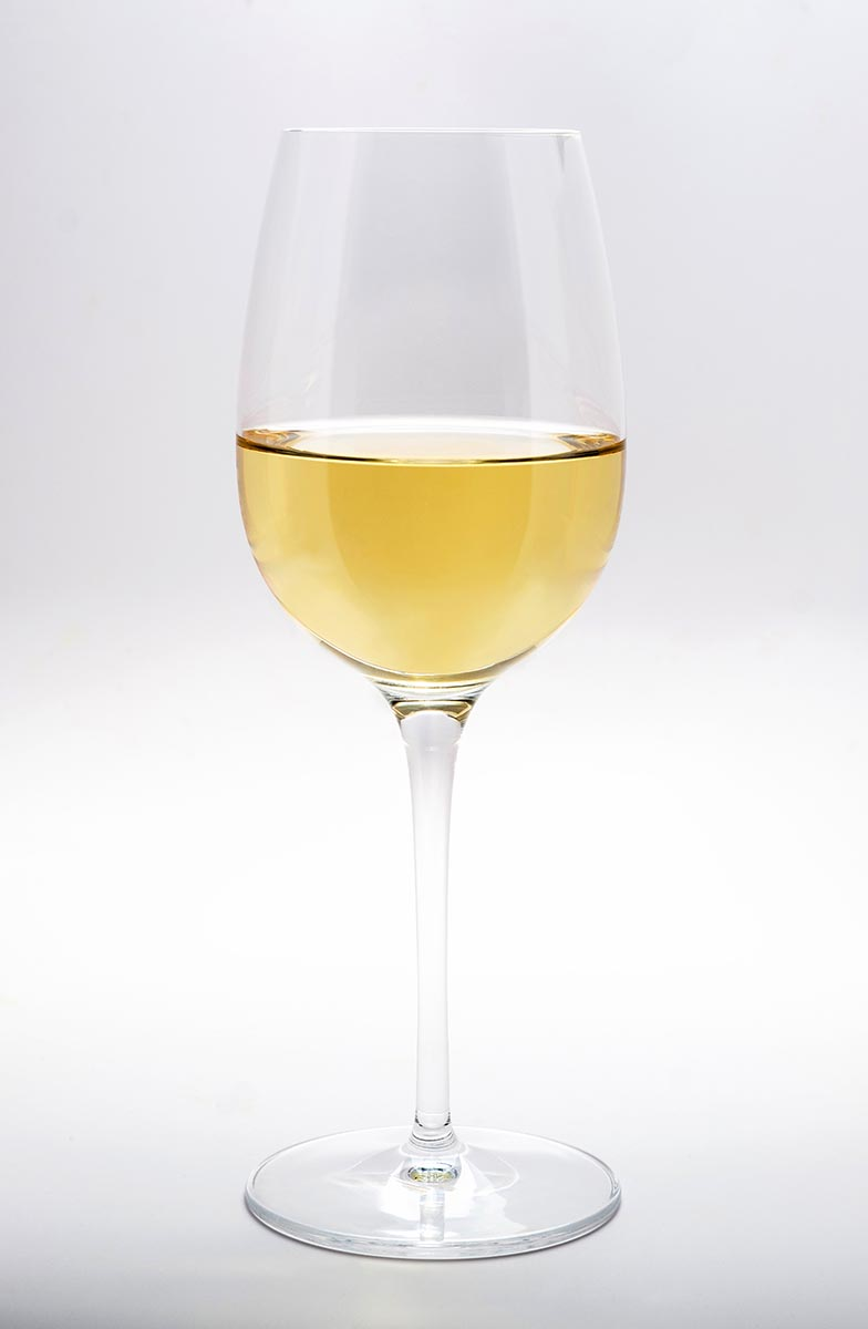Free stock photo A glass of white wine against white background
