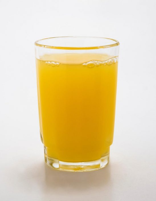 Free stock photo Glass or orange juice against a white background
