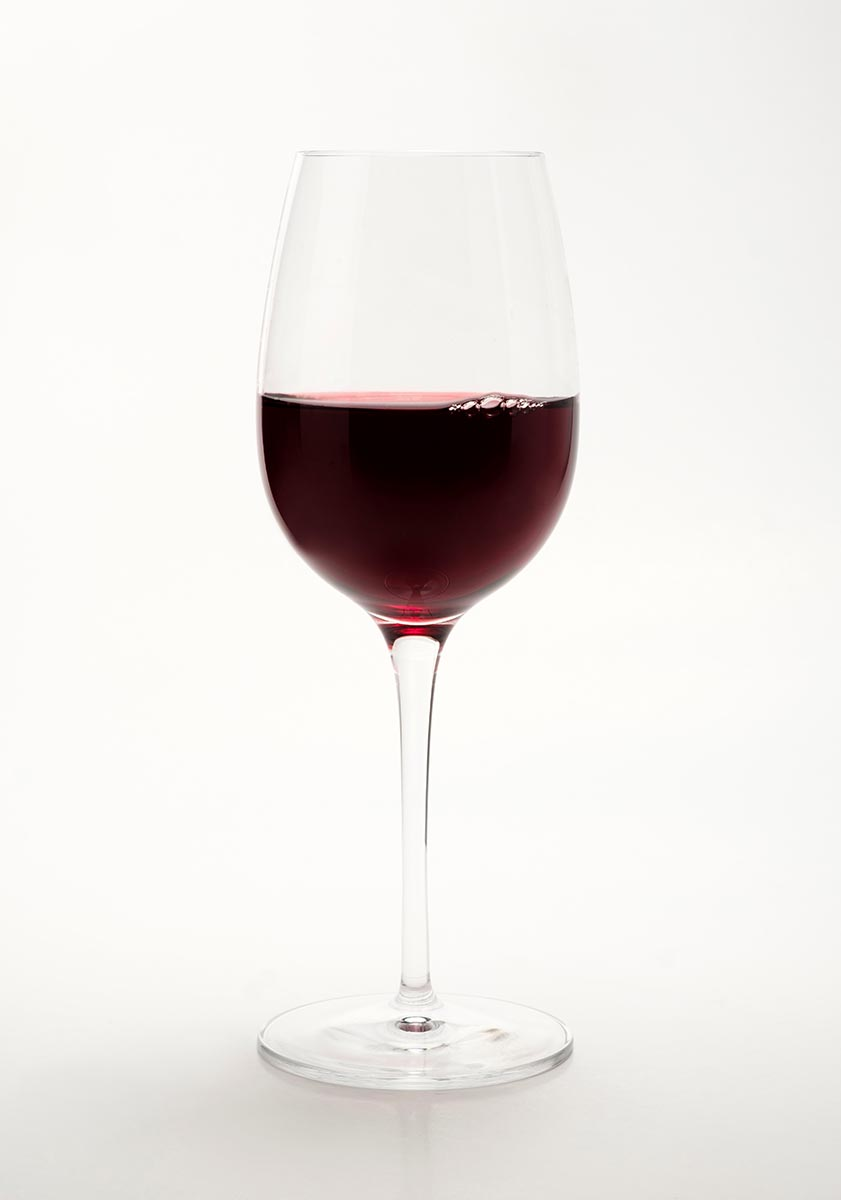 Free stock photo Glass of red wine on a white background