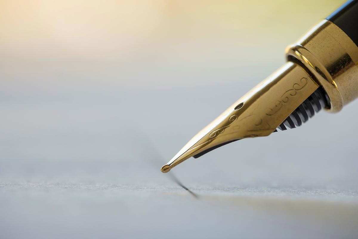 Free stock photo Fountain pen point about to sign a paper
