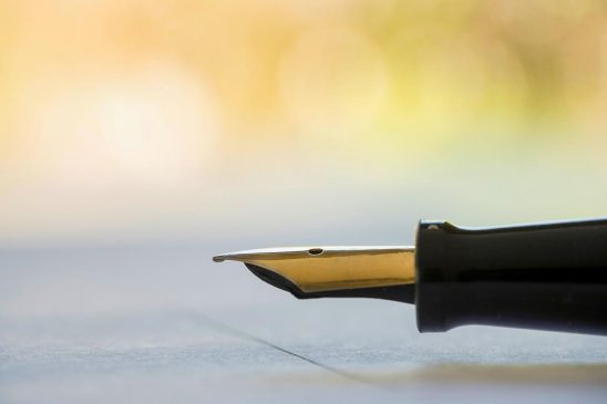 Free stock photo Antique fountain pen resting on a paper to be signed