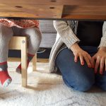 Free stock photo View of mother and child from under a table